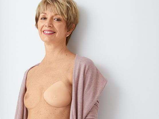 how to wear a contact breast form