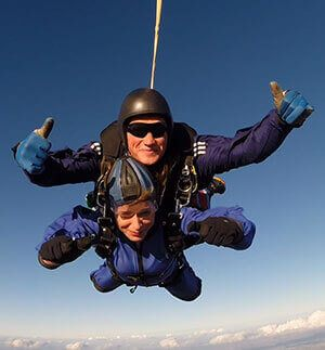 Breast cancer survivor skydives for charity